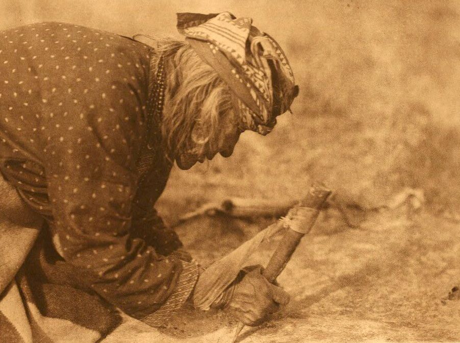American Indians : Blackfoot Fleshing a Hide.