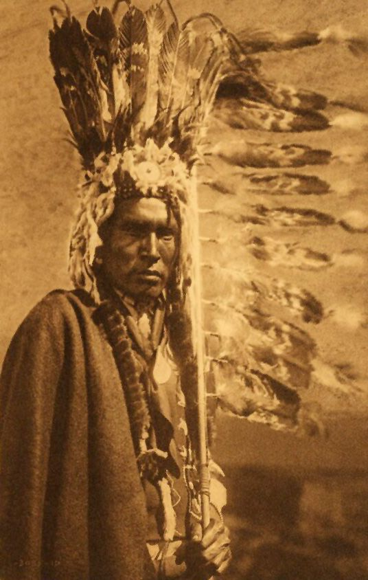 American Indians : Piegan War Bonnet and Coup Stick.