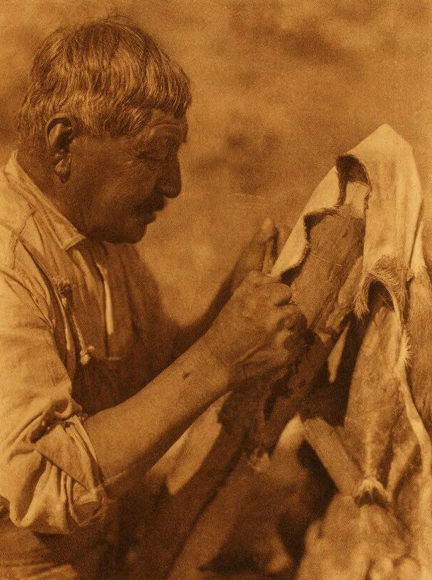 Washo Indian Scraping a Deerskin.