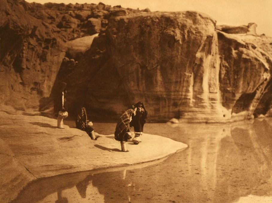 A Photograph of Acoma Water Carriers.