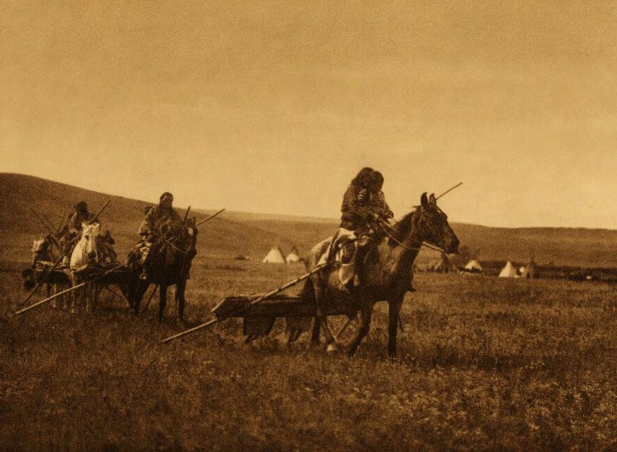 A Photograph of Atsina Indians Moving Camp.