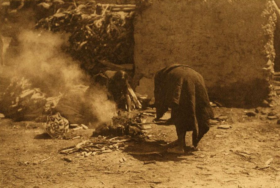 A Photograph of American Indians Firing Pottery.