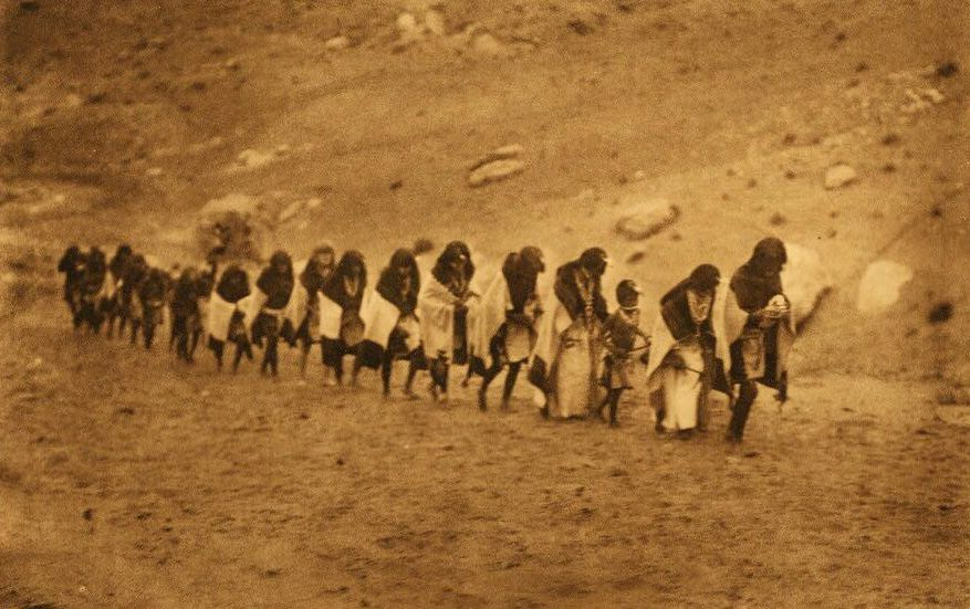 A Photograph of Flute Dancers Approaching The Spring.