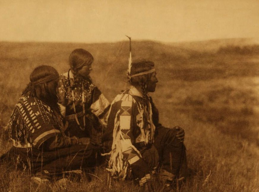 A Photograph of Piegan Indians Overlooking The Camp.