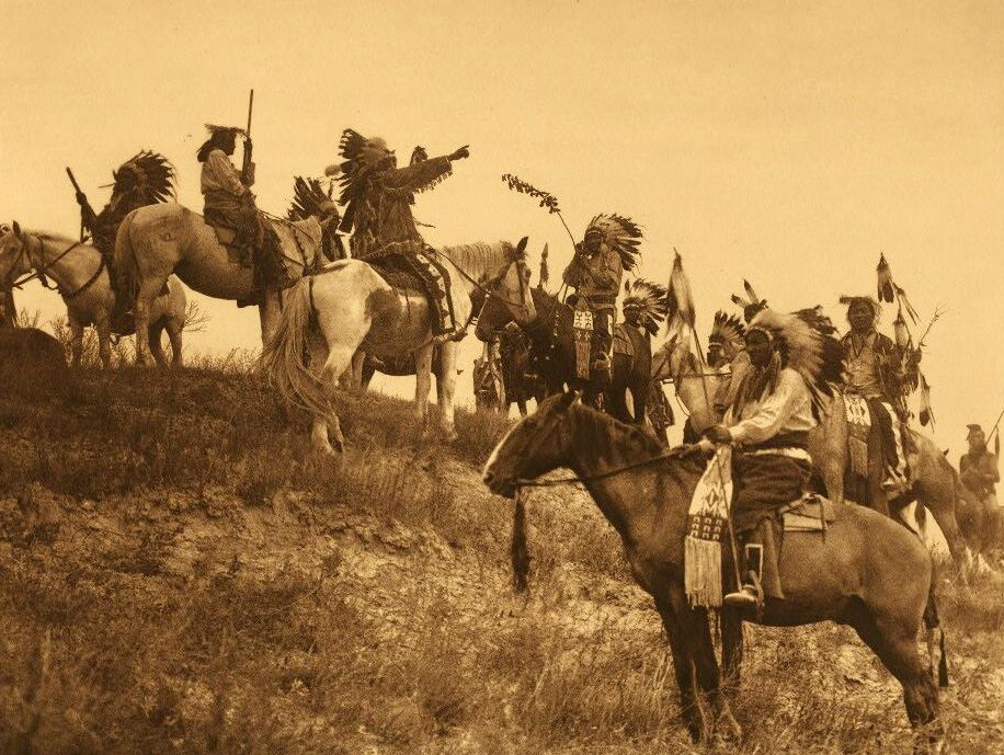 A Photograph of American Indians Planning a Raid.