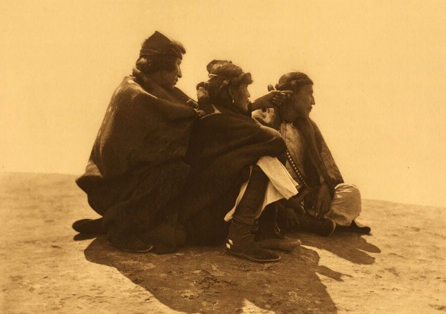 A Photograph of Navaho Indians Seeking out Point of Interest.