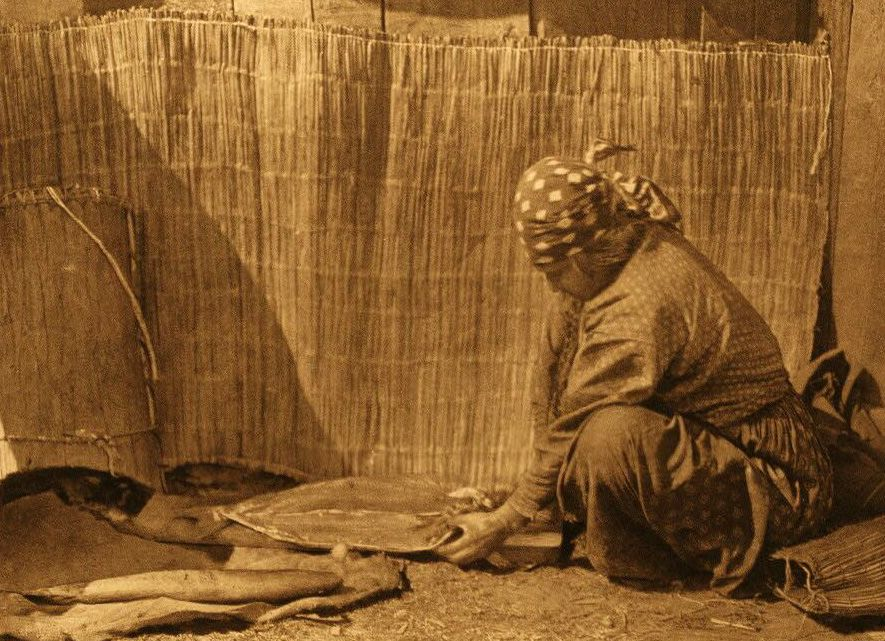 A Photograph of a Wishham Indian Woman Preparing Salmon.