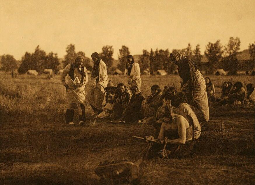 A Photograph of Cheyenne Priests Passing Before The Pipe.