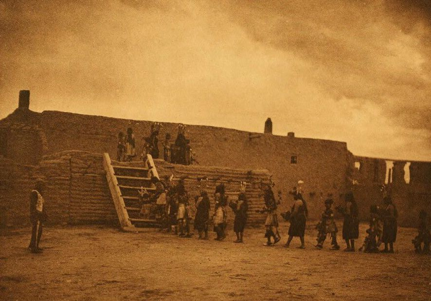 A Photograph of Tablita Dancers Returning to The Kiva [San Ildefonso].