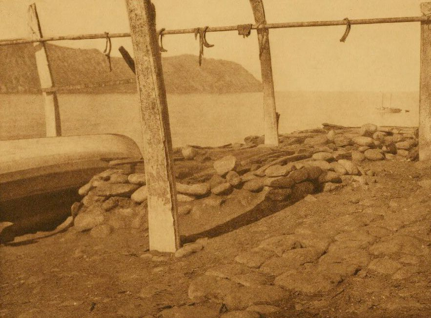 A Photograph of Underground House Tops with Whale Rib Drying Rack [Diomede].