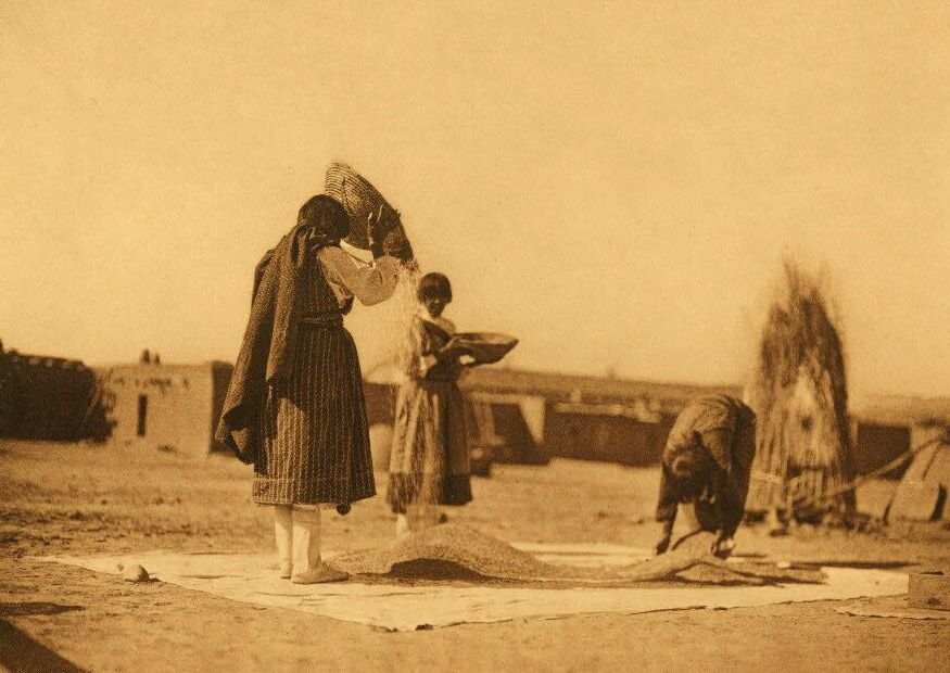A Photograph of American Indians Winnowing Wheat [San Juan].