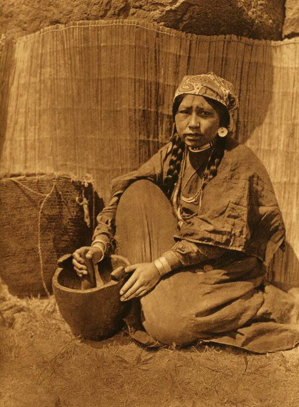 A Photograph of A Wishham Indian Woman Pounding Fish.
