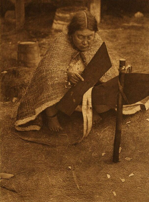 A Nakoaktok Indian Woman Preparing Cedar Bark.