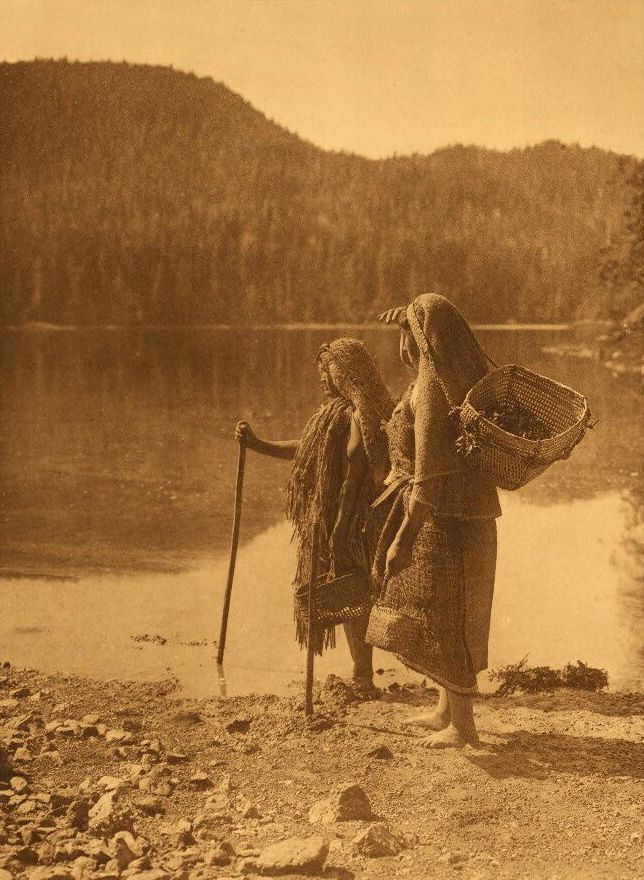 A Photograph of American Indian Women Waiting For The Canoe.