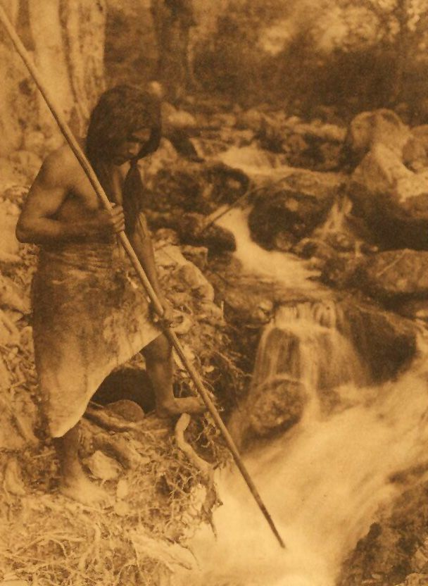 A Photograph of a Hupa Indian Watching For Salmon.