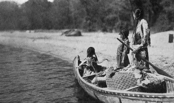 Ojibway Indian Woman and Two Girls with a Loaded Canoe Heading for Blueberry Camp.