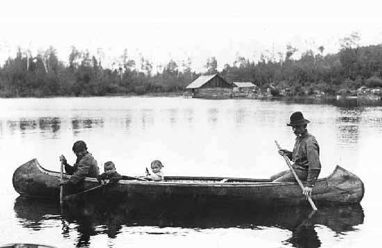 Ojibway Family in a Canoe, Vermilion Lake.