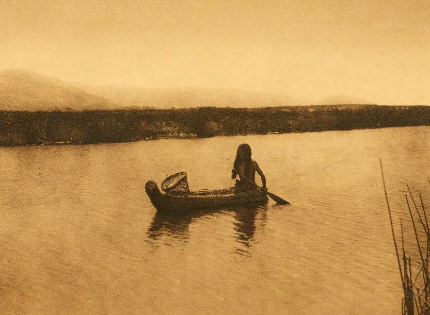American Indian canoe photograph : Pomo in the Tule Swamp Lake.
