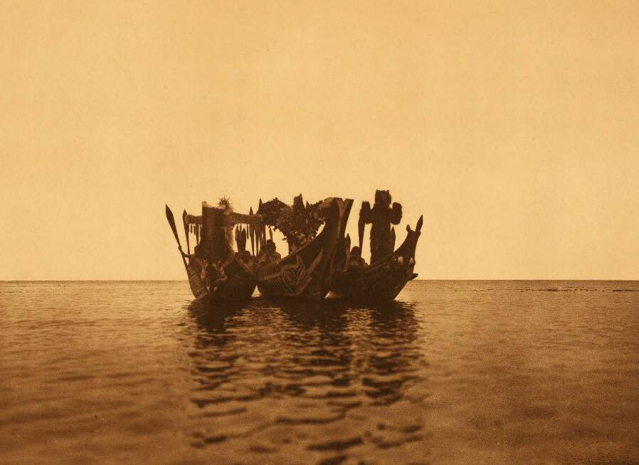 American Indian canoe photograph : Qagyuhl Masked Dancers in Canoes [b].