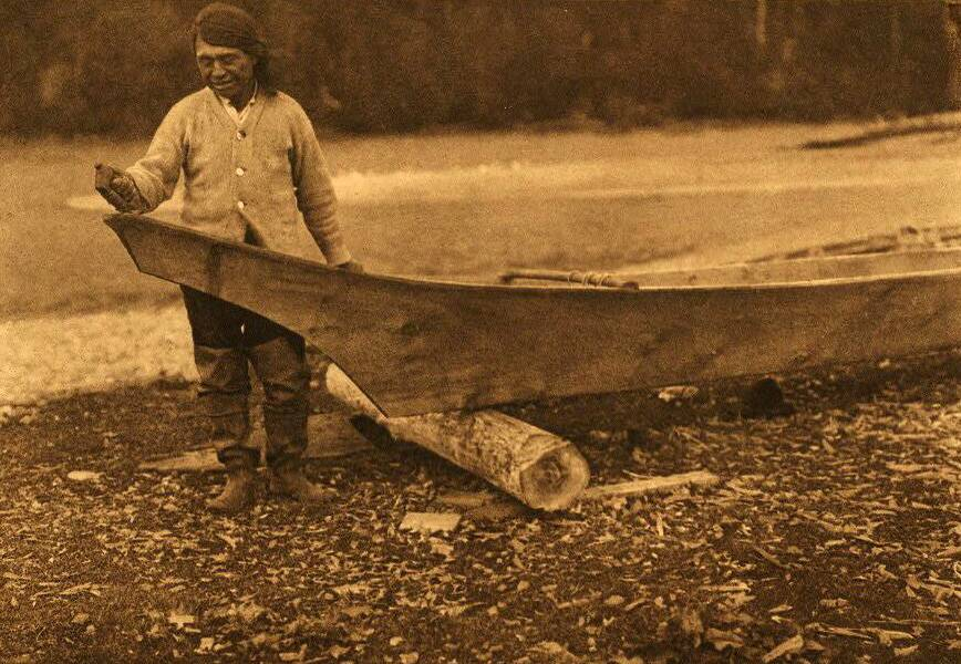 American Indian canoe photograph : Quinault Canoe Finishing.