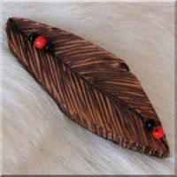 Burned Leather Feather Barrette with 5 Red and Black Glass Beads.