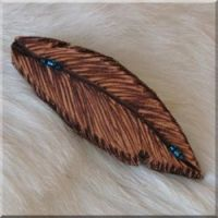 Burned Leather Feather Barrette with Blue Glass Beads.