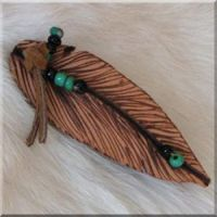 Burned Leather Feather Barrette with Green and Black Glass Beads.