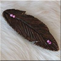 American Indian made Burned Leather Feather Barrette with Pink Glass Beads.