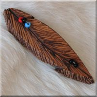Burned Leather Feather Barrette with Red, Blue and Black Glass Beads.