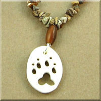 Bone Wolf Track Cutout and Horn Hair Pipes Necklace with Gemstone Chips.