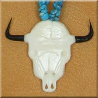 Carved Bone Steer Skull Necklace.