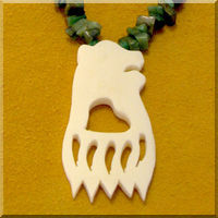 Carved Bone Bear Paw Cutout Necklace.