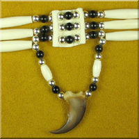Three Strand Bear Claw Hairpipe Choker.