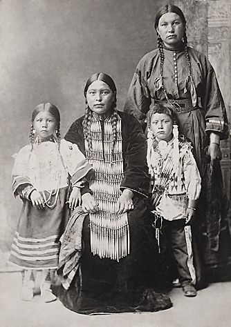 An old photograph of a Group of Four Sioux Indians.
