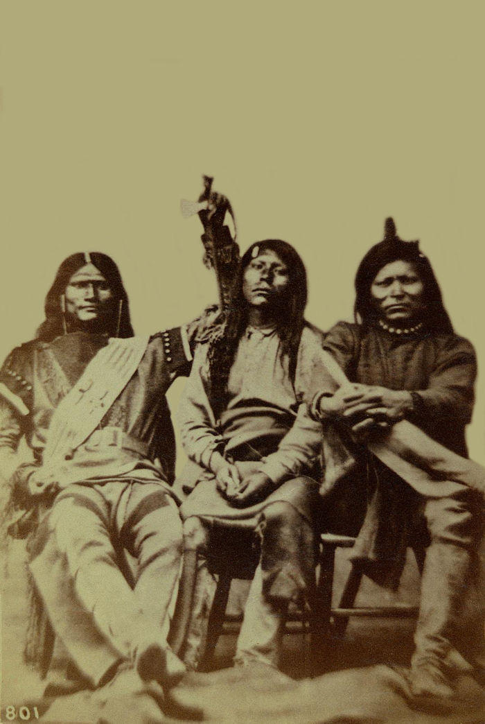 An old photograph of a Group of Three Pah-Utes 1869.