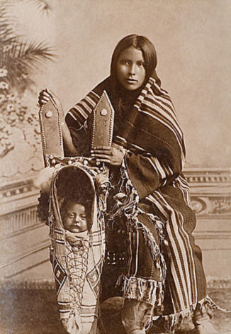 An old photograph of a Kiowa Mother and Child.