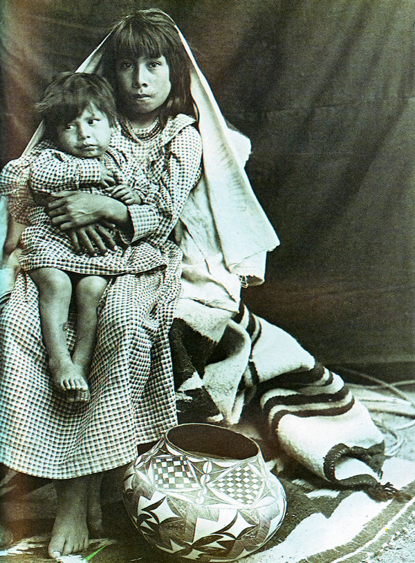 An old photograph of a Laguna Pueblo Woman and Child.