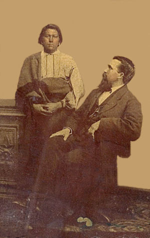 An old photograph of a Native American and a White Man.