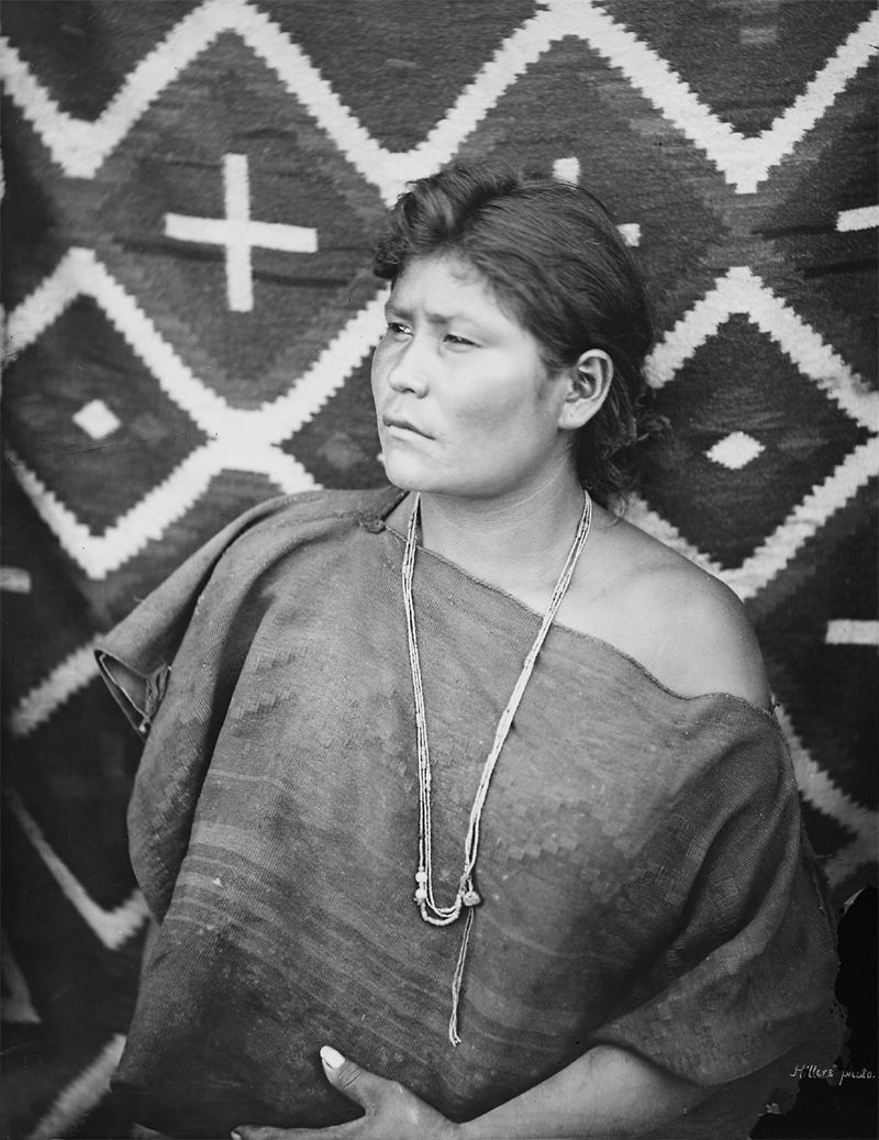 An old photograph of a Navaho Girl.