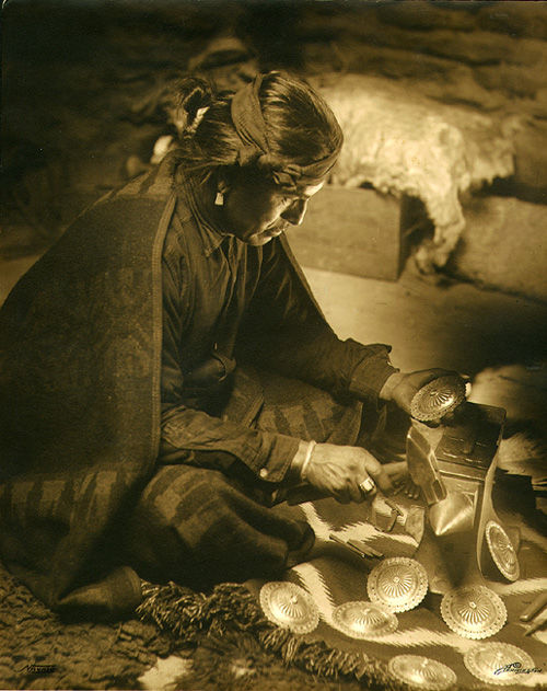 An old photograph of a Navajo Silversmith [B].