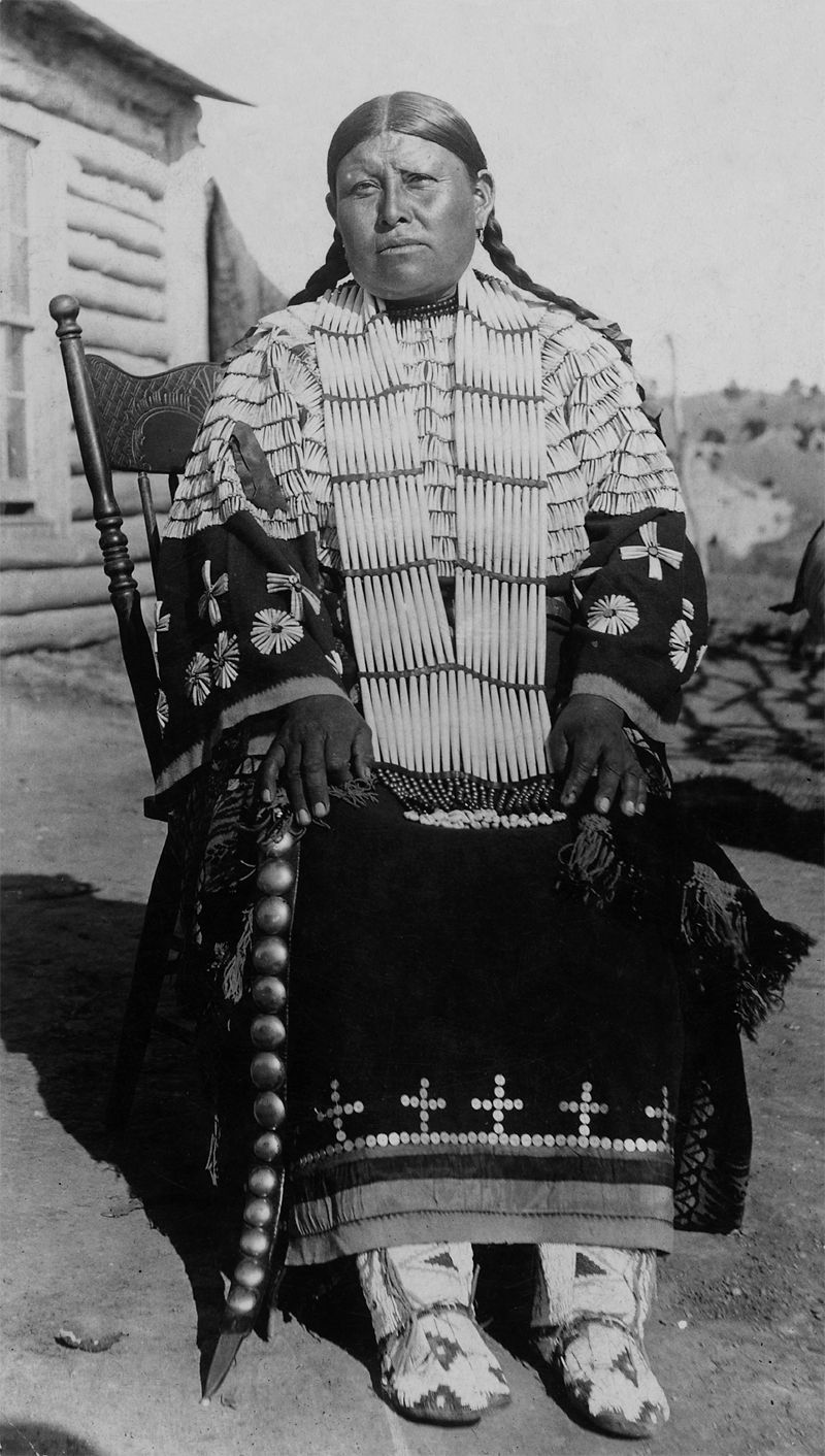 An old photograph of a Sioux Indian Woman in Ceremonial Dress.