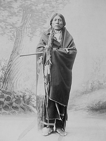 An old photograph of a Ute Indian Carries the Pipe and Tobacco Bag of a Cheyenne Warrior, Probably Killed by the Utes.