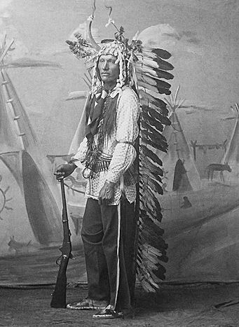 An old photograph of a Yankton Sioux Warrior in Dance Regalia.