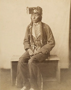 An old photograph of a Young Cheyenne Warrior aged 21 (Brother to Red Moon) 1869.