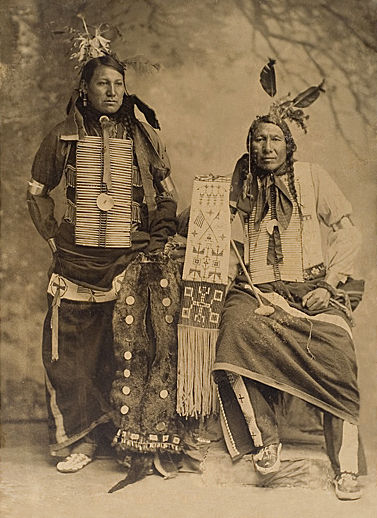 An old photograph of Amos Little aka Iron Hawk with Charles Chase Close To Lodge - Oglala 1900.
