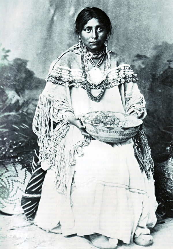 An old photograph of an Apache Woman in Traditional Bridal Costume.