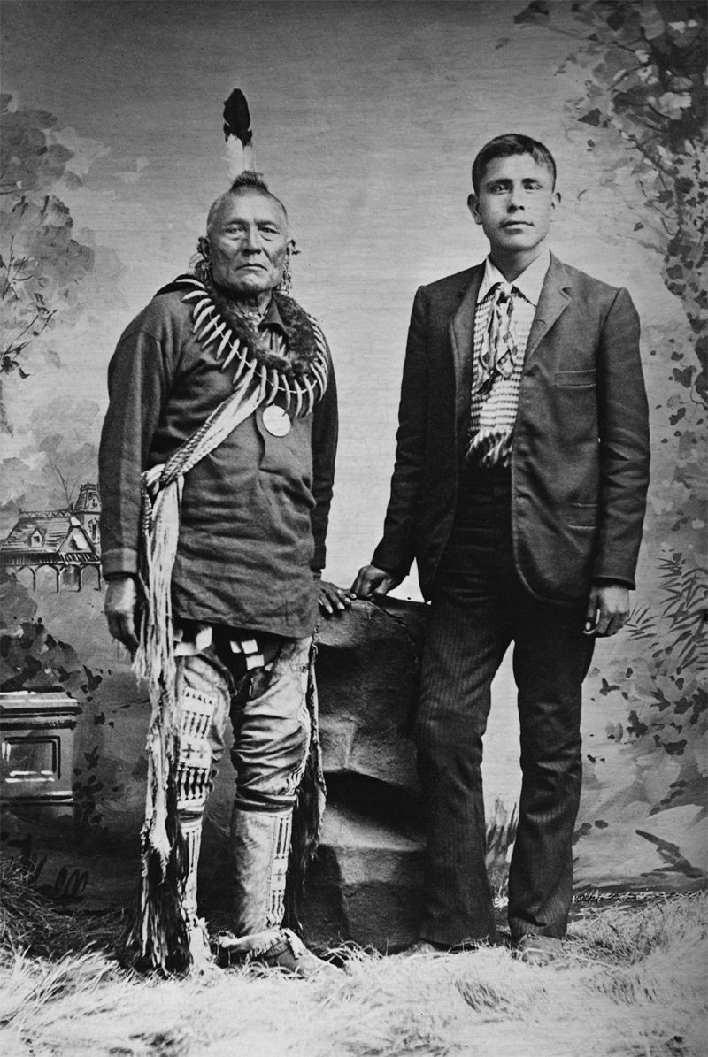 An old photograph of an Unidentified Native American with a White Man.
