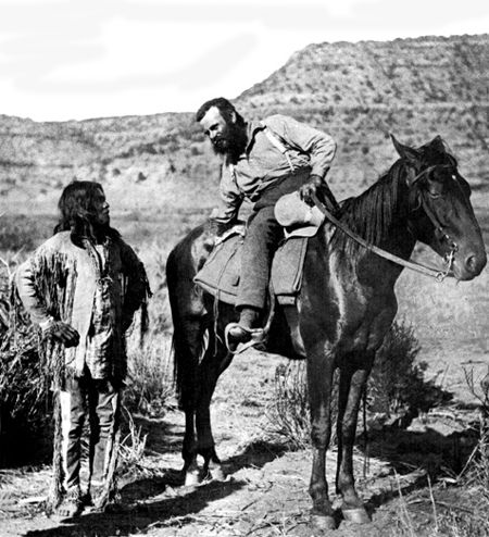 An old photograph of the Anthropologist John W Powell with Indian.