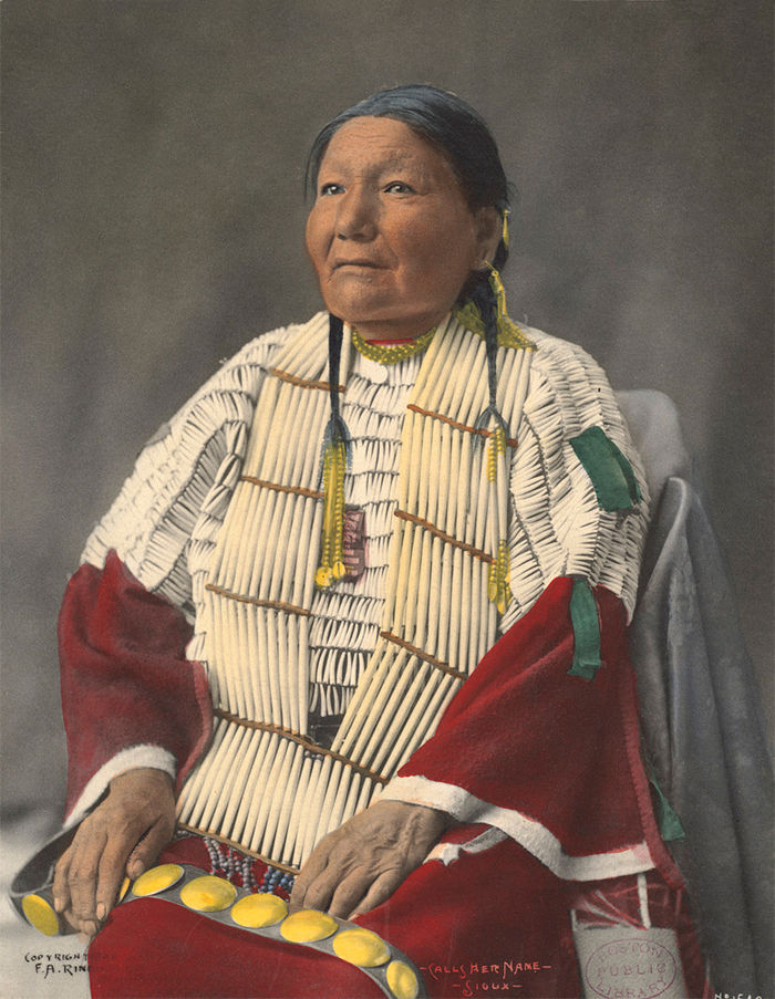 An old photograph of Calls Her Name - Sioux 1899 [Colorized].