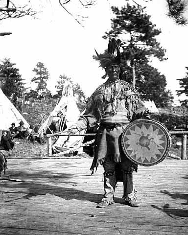 An old photograph of a Chippewa Medicine Man Singer with Ceremonial Turtle Clan Drum.